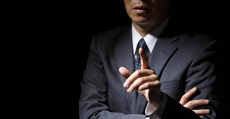 Man standing pointing his finger with black background
